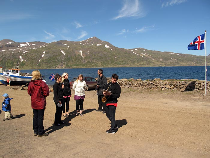 Djúpavík. Music III: Margrét S. (Magga), the national holiday. - Gathering for the pageant, Magga plays saxophone. (17 June 2010)