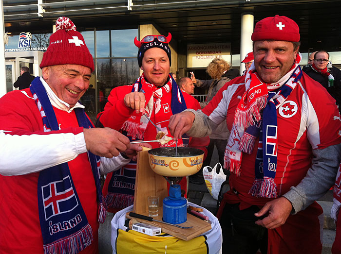 Reykjavík. Soccer game Iceland vs Switzerland. - Fans from Switzerland having fun. And good a good meal - Cheee Fondue. (16 October 2012)